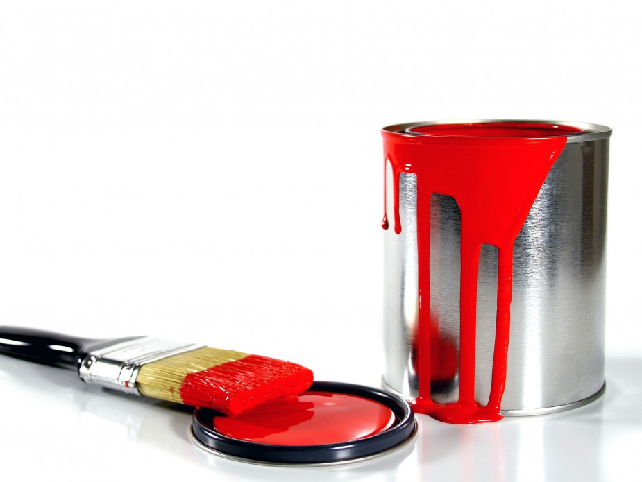 red paint bucket and brush
